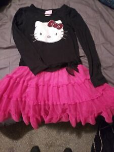 Hello Kitty Black with pink ruffles Size 5T has long sleeves.? No rips or tears