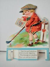 """golfing boy, mechanical Valentine; 8.5"""" by 6.25"""""""" arm moves; Made in Germany"""