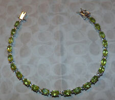 APPROX  20 CTW OVAL CUT  GENUINE PERIDOT TENNIS BRACELET 8 INCHES DBL LOCKING