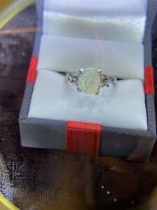 Estate Find.. Beautiful Oval Opal with CZ Accents Ladies Size 7