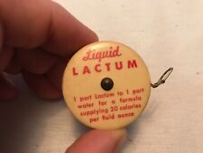 Liquid & Powdered Lactum Celluloid Vintage Tape Measure
