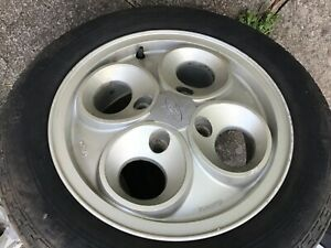 Three Escort wheels cloverleaf,1 brand new others used,no dings.xr3i,xr3.ford,