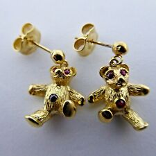 Teddy's 9ct gold ruby eye  earrings butterfly fittings