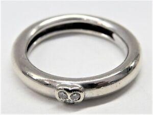 Tiffany & Co WoMen's 4.5 grams 750 white gold & Diamonds size 7 1993