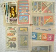 **LARGE ASSORTMENT OF WORLD WIDE STAMPS ALL IN CELLOPHANE PACKETS**