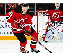 NEW JERSEY DEVILS JACOB JOSEFSON SIGNED BRINGING THE PUCK UP 8X10