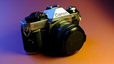 Vintage Canon AE-1 Program 35mm Camera with Canon FD 50mm lens. Great Condition.