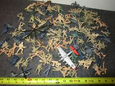 A Vintage Lot Of Assorted Plastic Toy Soldiers And A Metal Helicopter & Airplane