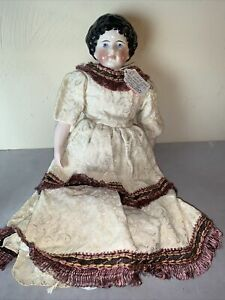 "Antique China Doll, 16"" tall, original head B&D.    +"