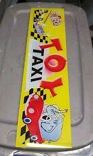toy taxi arcade crane claw glass marquee