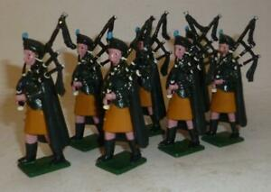 SEVEN WHITE METAL UNIDENTIFIED IRISH GUARDS PIPERS - 54mm SCALE - 1960/70's