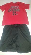 Boys M Nike t shirt, M Teamwork black basketball shorts. Very good condition!