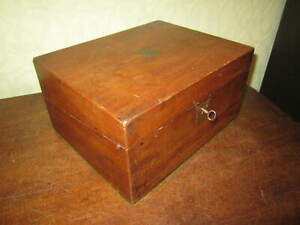 An antique Victorian mahogany writing slope with working lock and key