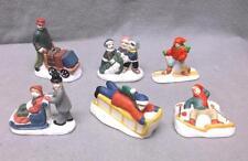 6 porcelain Christmas village figures, people in snow, sled, porter, skis