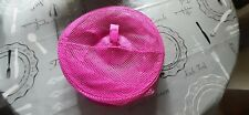 Pink Ikea net hanging storage shelves