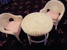 table and chairs in pastel pink wicker