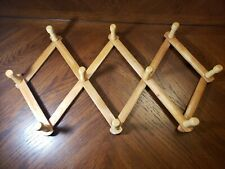 Accordian expandable wood 10 hook rack wall hanger for hats, scarves, etc