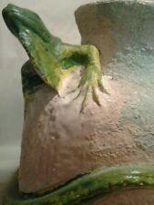Large unglazed chalkware vase with iguana breaking through