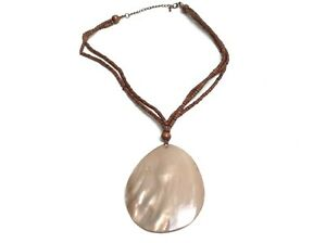 Beach multi strand necklace with wood and mother of pearl disk pendant chain