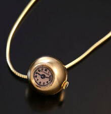 WOMAN'S 18K YELLOW GOLD BALL FORM PENDANT WATCH WITH 14K CHAIN CA1950S
