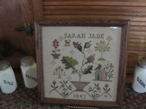 framed crosstitch sampler