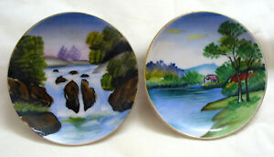 Two hand painted Small Wall Plates