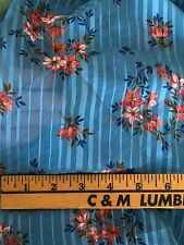 Bty Lovely Blue Sheer Gauze Fabric with Satin Ribbons and Orange Flowers, 46""