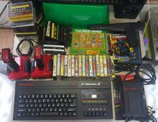 Zx Spectrum+2 plus two 128K computer console games bundle, joysticks & light gun