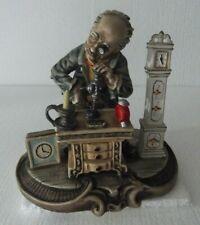 Figura composición Viejo relojero, ceramica porcelana biscuit España vintage