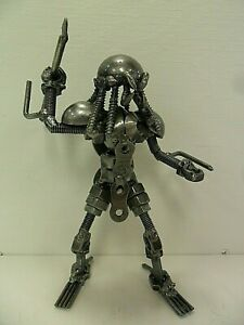 Metal Predator w/ Spear Mini Sculpture - Made From Recycled Metal -