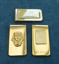 THREE GOLD PLATED MONEY CLIPS