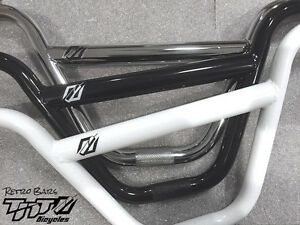 NEW - TNT BICYCLES RETRO BMX HANDLEBAR - Chrome, Black, White