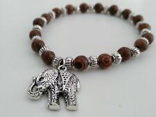 Pulsera cuentas madera elastica con elefante indio 18 cm de largo artesania