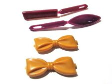 LOT OF FOUR CHILDRENS UNUSED HAIR BARRETTES CELLULOID BOWS GOLDEN YELLOW PLUM