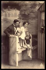 Family with old DOLL in a PUPPET SHOW. Old real Photo postcard Germany 1910s