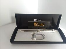 BRAND NEW LODIS FINE WRITING INSTRUMENTS PEN AND KEY RING SET.  (M-5)