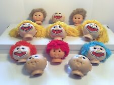 FUNNY BABY      11 Doll Heads