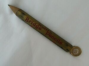 VINTAGE LARGE WOLFF'S BRIDGE ADVERTISING PENCIL CONTAINING 4 PENCILS