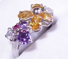 Simulated Gemstone ring, floral motif, 9 stones 4.15ct, in platinum bond. Size O