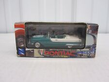 1:43 scale 1955 Pontiac Starchief Convertible Diecast New Ray Toys Teal & white