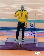 USAIN BOLT JAMAICA SPRINTER OLYMPIC GOLD AUTOGRAPHED SIGNED PHOTO 8X10 JSA COA