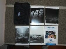 2015 Ford Focus ST owners manual with black case.