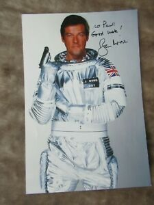 Roger Moore Hand Signed Photograph  DEDICATED TO PAUL Lot 2