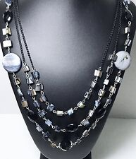 Triple Strand Black Lip Shell Necklace Accented With Faceted Black Beads