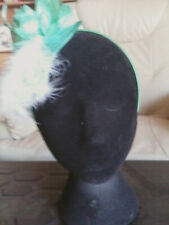 Fascinator - green flower with sinamay& white feathers on sinamay base on h/band