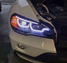 FARI NERI BMW X5 E70 ANGEL EYES XENON SERIE AFS CON LUCE CURVA 06-10 + MOTORINI