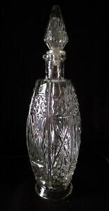 Bottiglia in vetro lavorata vintage con tappo capienza 0.750 altezza 31 cm.