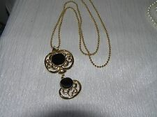 Vintage Long Goldtone Bead Chain with Double Swirl Black Enamel Circle Pendant