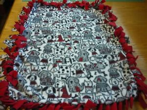 Handmade fleece tie blanket of sketched pups on red for a small pet