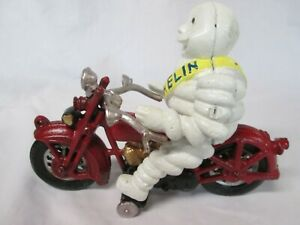 Michelin Tires Man Bibendum on Red Motorcycle Cast Iron Toy